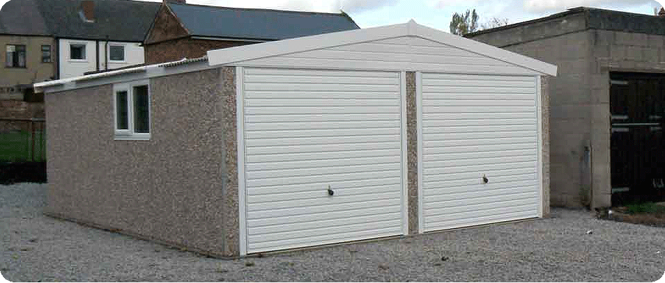 concrete garage with brick front posts